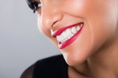 stock-photo-50018378-beautiful-laughing-woman-with-red-lips-and-white-teeth-closeup
